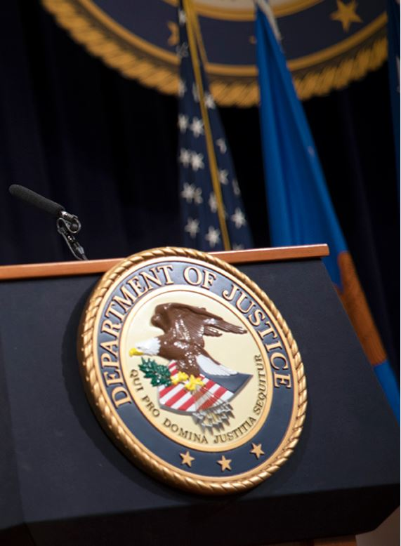Picture of the podium at the Great Hall at the Department of Justice.