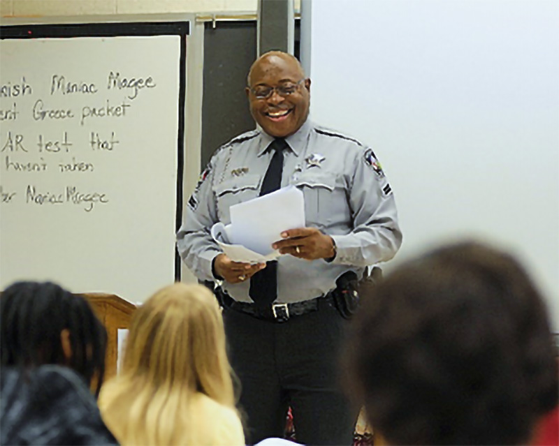 Photo of Deputy Charles Peele of the Harnett County, NC, Sheriff's Office leads a class taking the G.R.E.A.T. program.