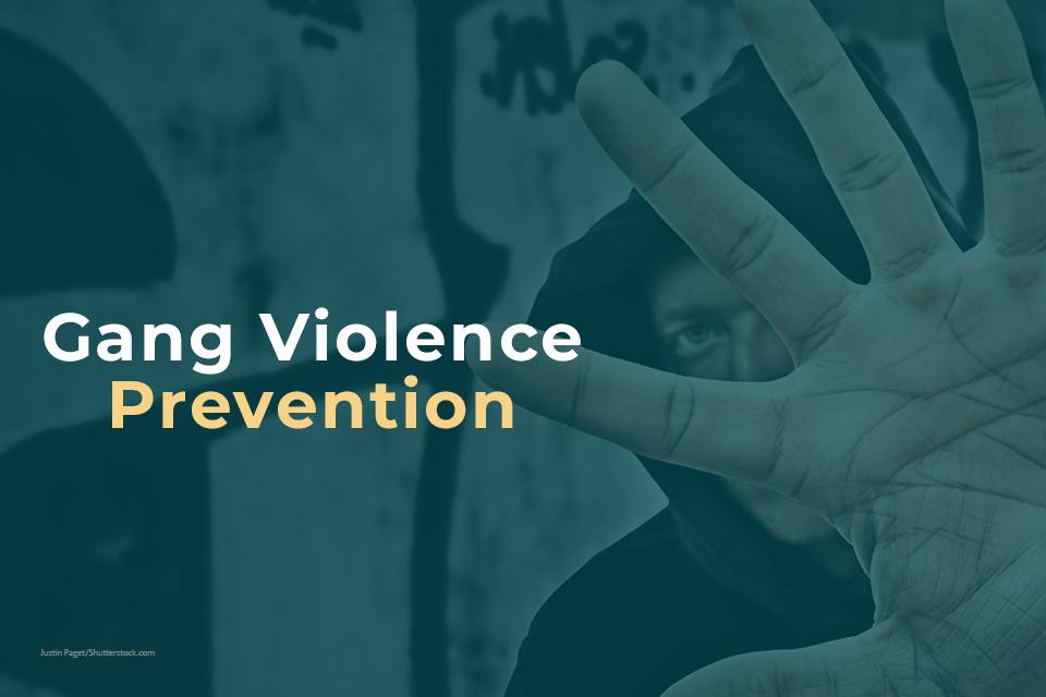 Gang Violence Prevention with image of male holding up hand in front of his face